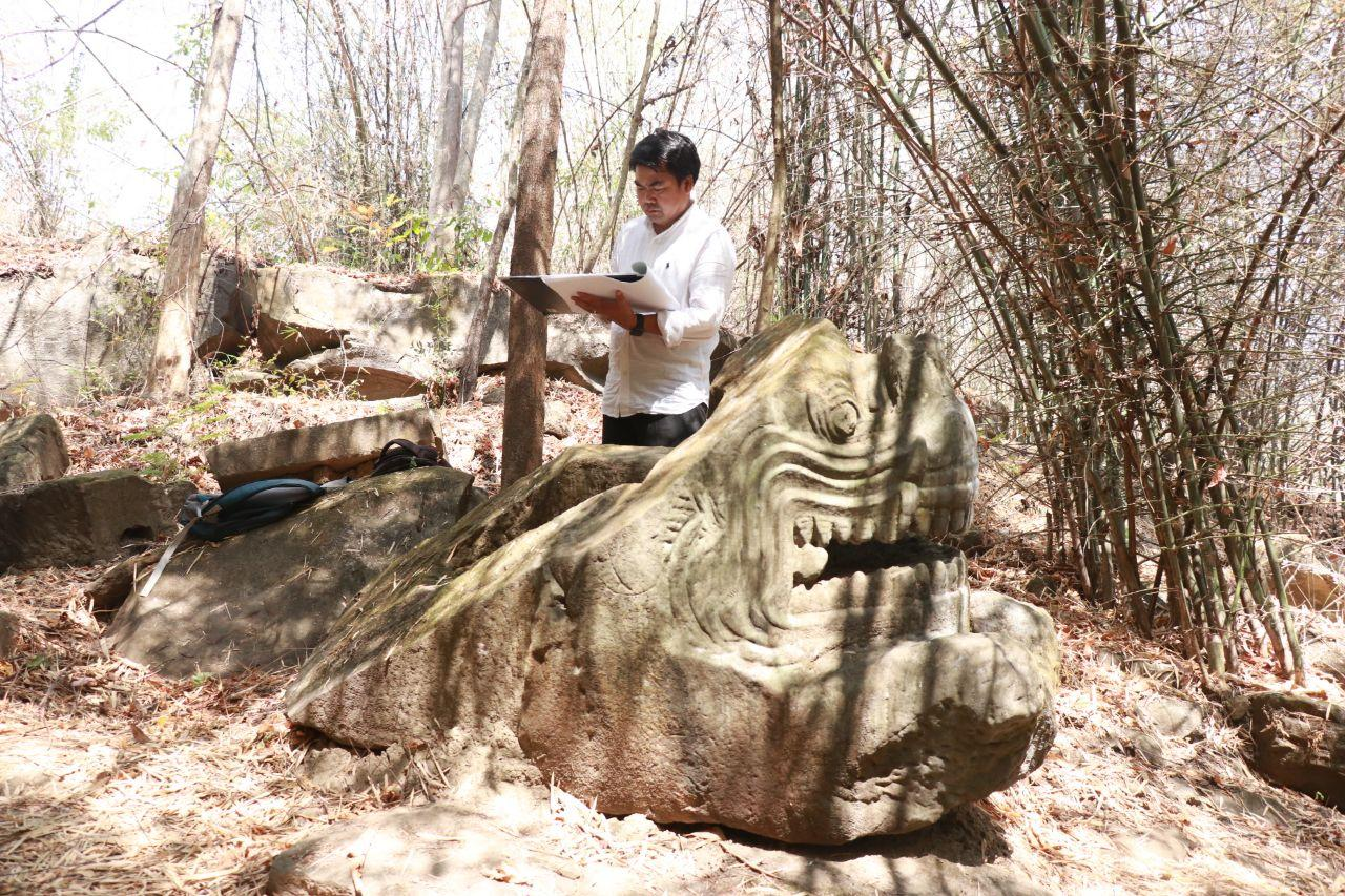 Ancient statue found carved in rock in Siem Reap