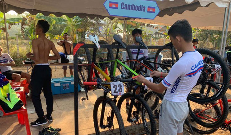 Cambodian cyclists prepare their bikes prior to the races. CCF