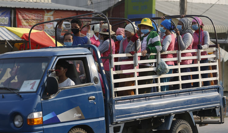 A truck transports a group of workers in Phnom Penh. KT/ Siv Channa