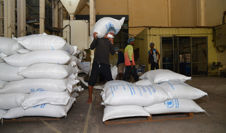 Rice is loaded ready for distribution by the World Food Programme. KT/Pann Rachana