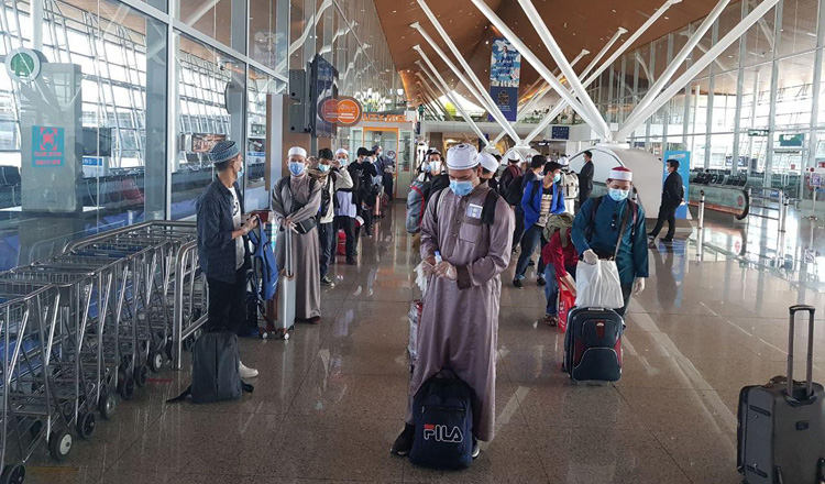143 Cambodians at  Kuala Lumpur International Airport wait to board MH754 to return home. Supplied